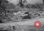 Image of Japanese airfield and planes at Lae destroyed by allied bombers New Guinea, 1943, second 49 stock footage video 65675030887