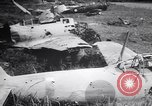 Image of Japanese airfield and planes at Lae destroyed by allied bombers New Guinea, 1943, second 52 stock footage video 65675030887