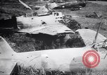 Image of Japanese airfield and planes at Lae destroyed by allied bombers New Guinea, 1943, second 53 stock footage video 65675030887