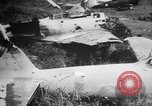 Image of Japanese airfield and planes at Lae destroyed by allied bombers New Guinea, 1943, second 54 stock footage video 65675030887