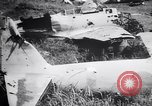 Image of Japanese airfield and planes at Lae destroyed by allied bombers New Guinea, 1943, second 55 stock footage video 65675030887