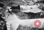 Image of Japanese airfield and planes at Lae destroyed by allied bombers New Guinea, 1943, second 56 stock footage video 65675030887