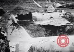Image of Japanese airfield and planes at Lae destroyed by allied bombers New Guinea, 1943, second 58 stock footage video 65675030887