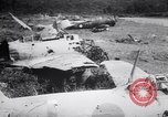 Image of Japanese airfield and planes at Lae destroyed by allied bombers New Guinea, 1943, second 61 stock footage video 65675030887