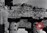 Image of soldiers at Greek temple of Hera World War 2 Paestum Italy, 1943, second 5 stock footage video 65675030900