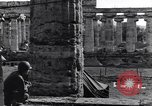 Image of soldiers at Greek temple of Hera World War 2 Paestum Italy, 1943, second 21 stock footage video 65675030900