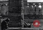 Image of soldiers at Greek temple of Hera World War 2 Paestum Italy, 1943, second 25 stock footage video 65675030900