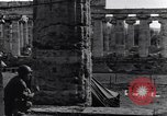 Image of soldiers at Greek temple of Hera World War 2 Paestum Italy, 1943, second 33 stock footage video 65675030900