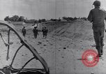 Image of US infantrymen marching Tunisia North Africa, 1943, second 54 stock footage video 65675030917