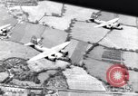 Image of bombing shipyards on Seine Le Trait France, 1943, second 19 stock footage video 65675030944