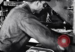 Image of Affixing car frame to chassis Dearborn Michigan USA, 1937, second 7 stock footage video 65675031007