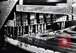 Image of Affixing car frame to chassis Dearborn Michigan USA, 1937, second 10 stock footage video 65675031007