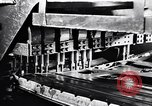 Image of Affixing car frame to chassis Dearborn Michigan USA, 1937, second 12 stock footage video 65675031007