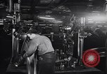 Image of Affixing car frame to chassis Dearborn Michigan USA, 1937, second 21 stock footage video 65675031007