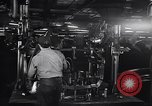 Image of Affixing car frame to chassis Dearborn Michigan USA, 1937, second 23 stock footage video 65675031007