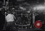 Image of Affixing car frame to chassis Dearborn Michigan USA, 1937, second 24 stock footage video 65675031007