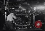 Image of Affixing car frame to chassis Dearborn Michigan USA, 1937, second 25 stock footage video 65675031007