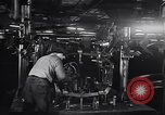 Image of Affixing car frame to chassis Dearborn Michigan USA, 1937, second 26 stock footage video 65675031007
