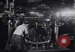 Image of Affixing car frame to chassis Dearborn Michigan USA, 1937, second 27 stock footage video 65675031007