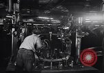 Image of Affixing car frame to chassis Dearborn Michigan USA, 1937, second 28 stock footage video 65675031007