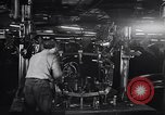 Image of Affixing car frame to chassis Dearborn Michigan USA, 1937, second 29 stock footage video 65675031007