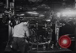 Image of Affixing car frame to chassis Dearborn Michigan USA, 1937, second 30 stock footage video 65675031007