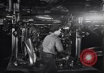 Image of Affixing car frame to chassis Dearborn Michigan USA, 1937, second 31 stock footage video 65675031007