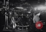 Image of Affixing car frame to chassis Dearborn Michigan USA, 1937, second 32 stock footage video 65675031007