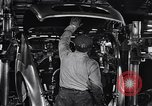 Image of Affixing car frame to chassis Dearborn Michigan USA, 1937, second 38 stock footage video 65675031007