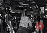 Image of Affixing car frame to chassis Dearborn Michigan USA, 1937, second 39 stock footage video 65675031007