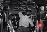 Image of Affixing car frame to chassis Dearborn Michigan USA, 1937, second 40 stock footage video 65675031007