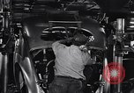 Image of Affixing car frame to chassis Dearborn Michigan USA, 1937, second 41 stock footage video 65675031007