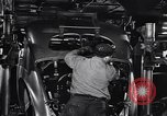 Image of Affixing car frame to chassis Dearborn Michigan USA, 1937, second 42 stock footage video 65675031007