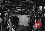 Image of Affixing car frame to chassis Dearborn Michigan USA, 1937, second 43 stock footage video 65675031007