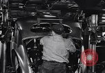 Image of Affixing car frame to chassis Dearborn Michigan USA, 1937, second 44 stock footage video 65675031007