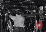 Image of Affixing car frame to chassis Dearborn Michigan USA, 1937, second 45 stock footage video 65675031007