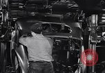 Image of Affixing car frame to chassis Dearborn Michigan USA, 1937, second 46 stock footage video 65675031007
