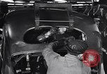 Image of Affixing car frame to chassis Dearborn Michigan USA, 1937, second 47 stock footage video 65675031007