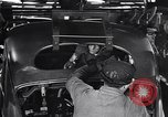 Image of Affixing car frame to chassis Dearborn Michigan USA, 1937, second 48 stock footage video 65675031007