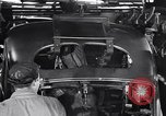 Image of Affixing car frame to chassis Dearborn Michigan USA, 1937, second 51 stock footage video 65675031007