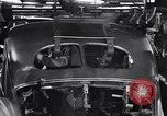 Image of Affixing car frame to chassis Dearborn Michigan USA, 1937, second 52 stock footage video 65675031007