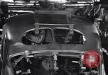 Image of Affixing car frame to chassis Dearborn Michigan USA, 1937, second 53 stock footage video 65675031007