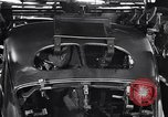 Image of Affixing car frame to chassis Dearborn Michigan USA, 1937, second 54 stock footage video 65675031007