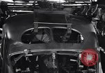 Image of Affixing car frame to chassis Dearborn Michigan USA, 1937, second 55 stock footage video 65675031007