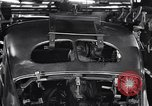 Image of Affixing car frame to chassis Dearborn Michigan USA, 1937, second 60 stock footage video 65675031007