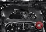 Image of Affixing car frame to chassis Dearborn Michigan USA, 1937, second 61 stock footage video 65675031007