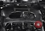 Image of Affixing car frame to chassis Dearborn Michigan USA, 1937, second 62 stock footage video 65675031007