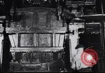 Image of Metal pressing machine Dearborn Michigan USA, 1930, second 14 stock footage video 65675031014