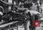 Image of Ford Motor Company assembly line Highland Park Michigan USA, 1917, second 2 stock footage video 65675031026