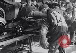 Image of Ford Motor Company assembly line Highland Park Michigan USA, 1917, second 3 stock footage video 65675031026
